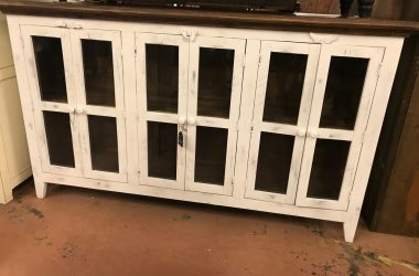 distressed white console with 6 glass doors and brown top