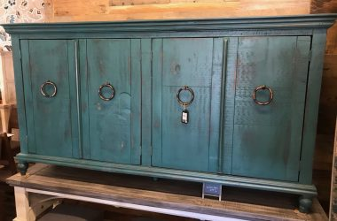 teal console w/4 doors with wrought iron pulls